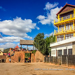 The gateway into Ambohimanga include this main gate Ambatomitsanaga, which features a traditional stone disc door (vavahady) seen to  the right to the gate, Antananarivo, Madagascar