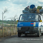An overloaded old taxi brousse (Renault Trafic) on the coastal road near Ifaty heading to the regional capital Toliara, Madagascar